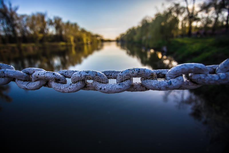 Iron chain links. On river background stock images