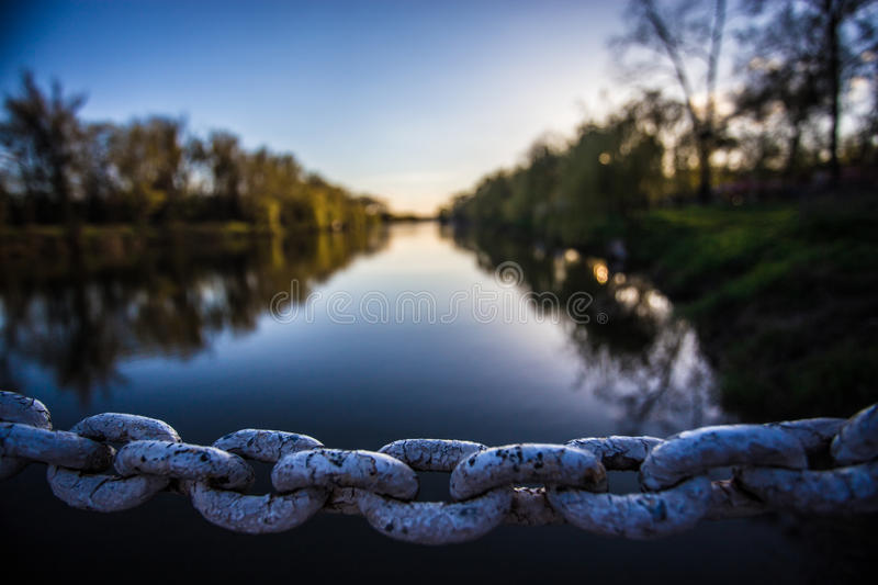 Iron chain links. On river background stock photography