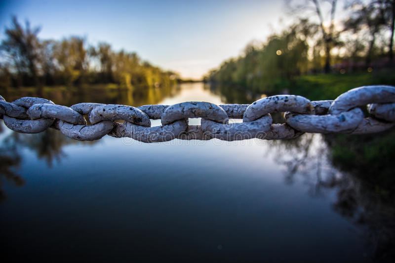 Iron chain links. On river background royalty free stock photos