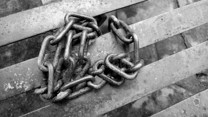 Iron chain with black and white picture royalty free stock photos