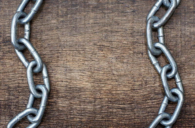 Iron chains parallel position. To form a wave on the background wood texture royalty free stock photos