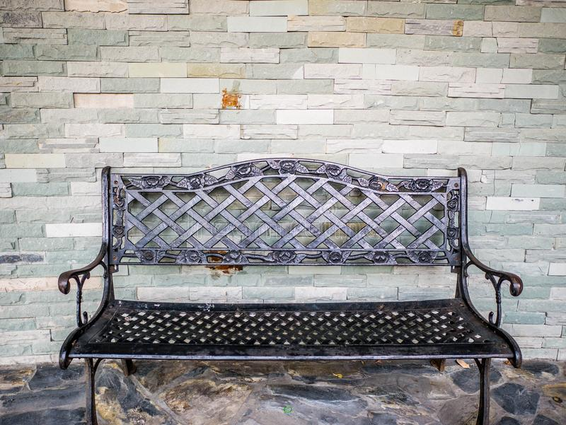 Iron chair and Brick Wall royalty free stock photos