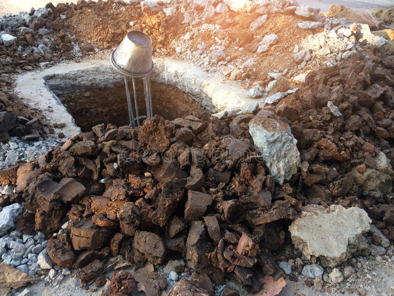 Iron-clay pits for post construction. stock photos