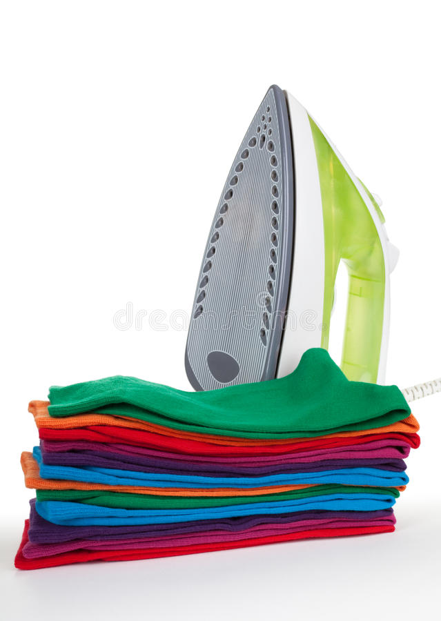 Iron and clothes. Electric iron and clothes on a white background royalty free stock images
