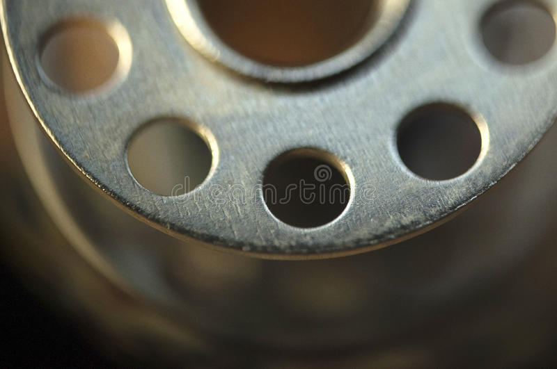 Iron coil. For sewing whits holes royalty free stock photography