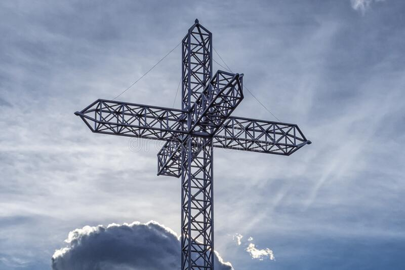 Iron cross of a mountain peak. With sky in background royalty free stock images