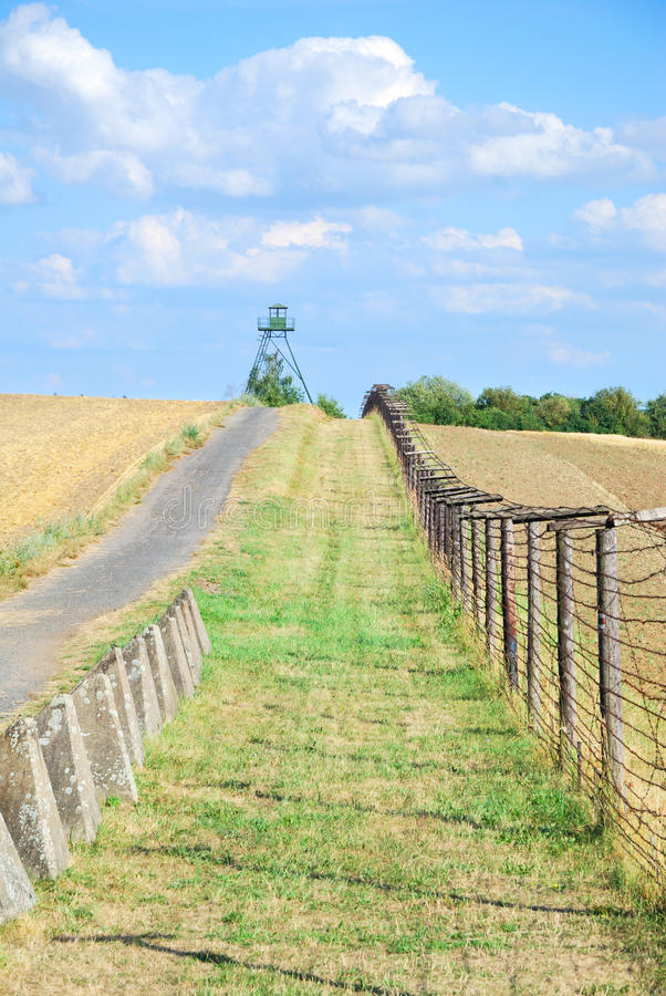 Iron curtain and watchtower with patrol road in former Czechoslovakia. Central Europe royalty free stock photography