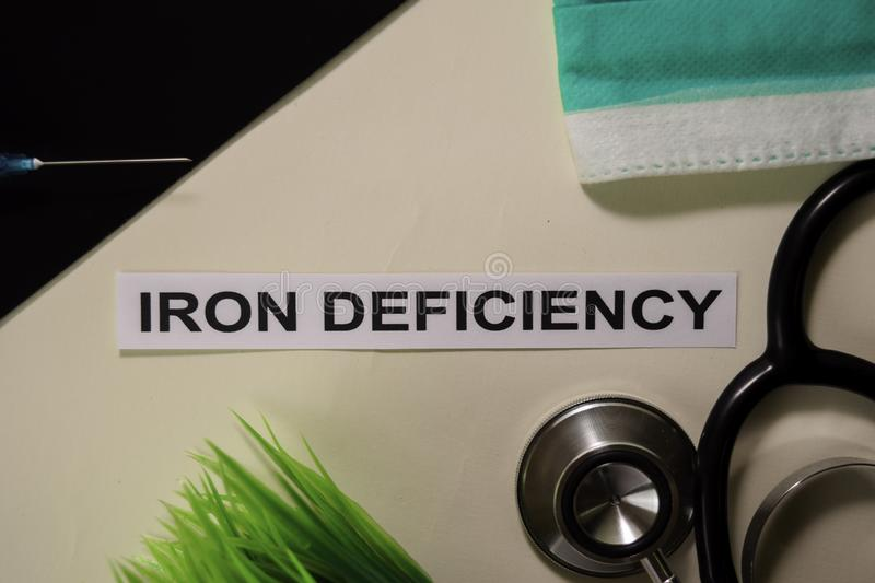 Iron Deficiency with inspiration and healthcare/medical concept on desk background royalty free stock photo