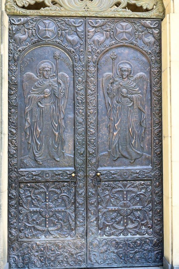 Iron door of Georgian church stock photos
