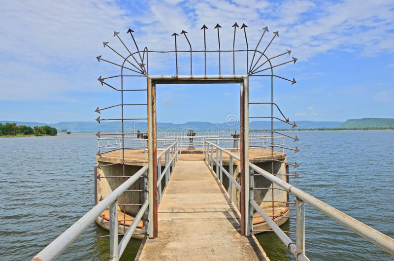 Iron door and guards for floodgate saving on the bridge. In reservoir in Thailand stock photo