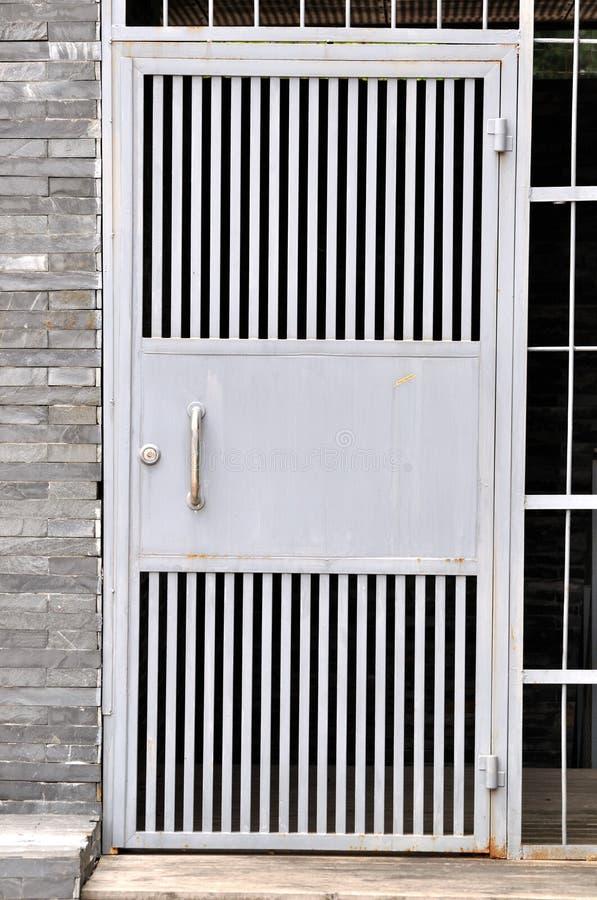 Iron door in plain style
