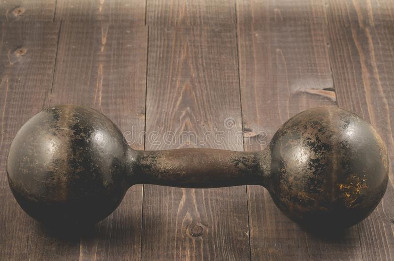 Iron dumbbell in fitness gym/Dumbbell in fitness gym on a dark w royalty free stock image