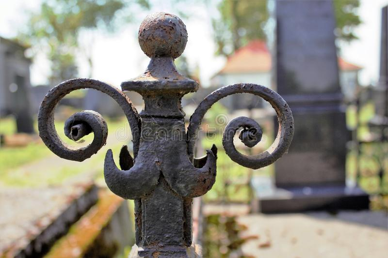 Iron fence on abandoned graveyard royalty free stock image