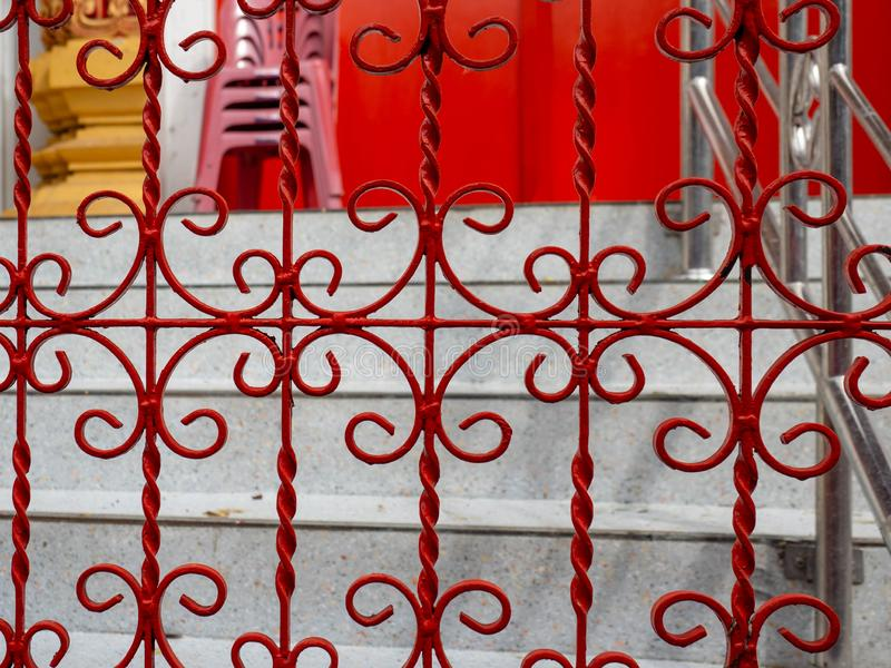 Iron fence color red to prevent theft,In temple at Bangkok Thailand. Iron fence color red to prevent theft In temple at Bangkok Thailand stock photography