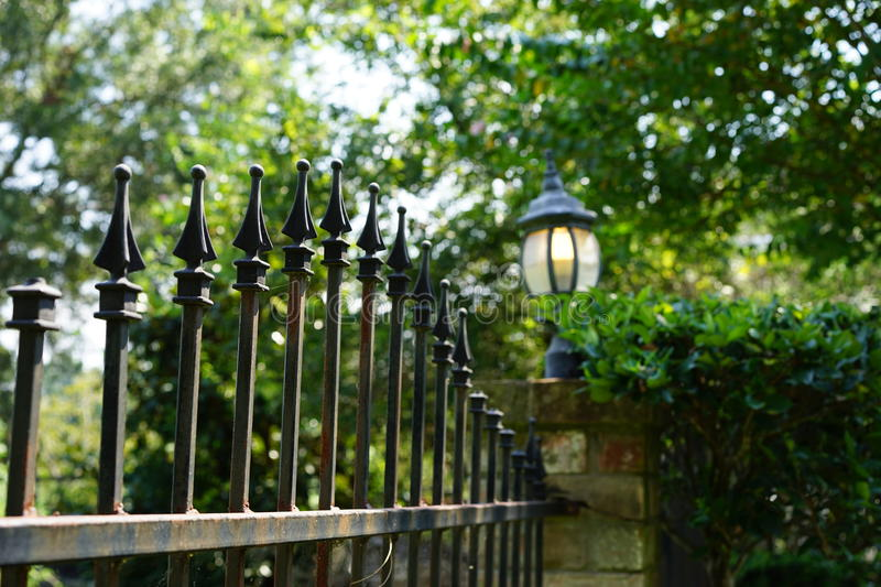 Iron fence and lamp surrounds estate stock photos