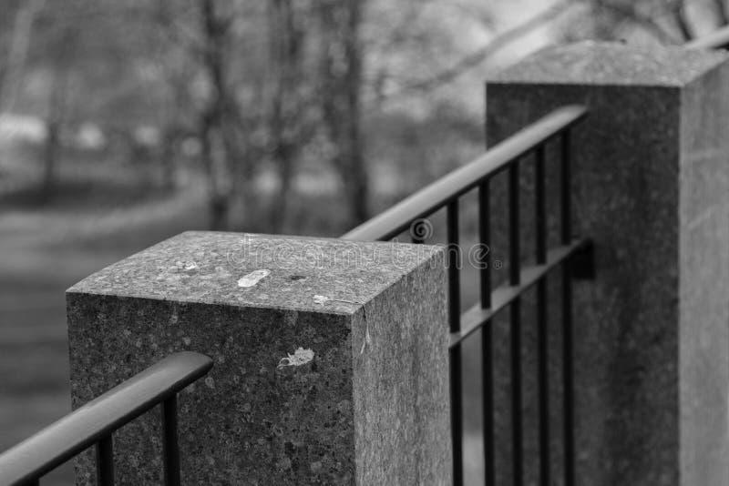 Iron fence with pillars of stone royalty free stock photos