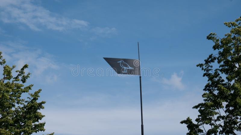 An iron flag flutters in the wind. royalty free stock photo