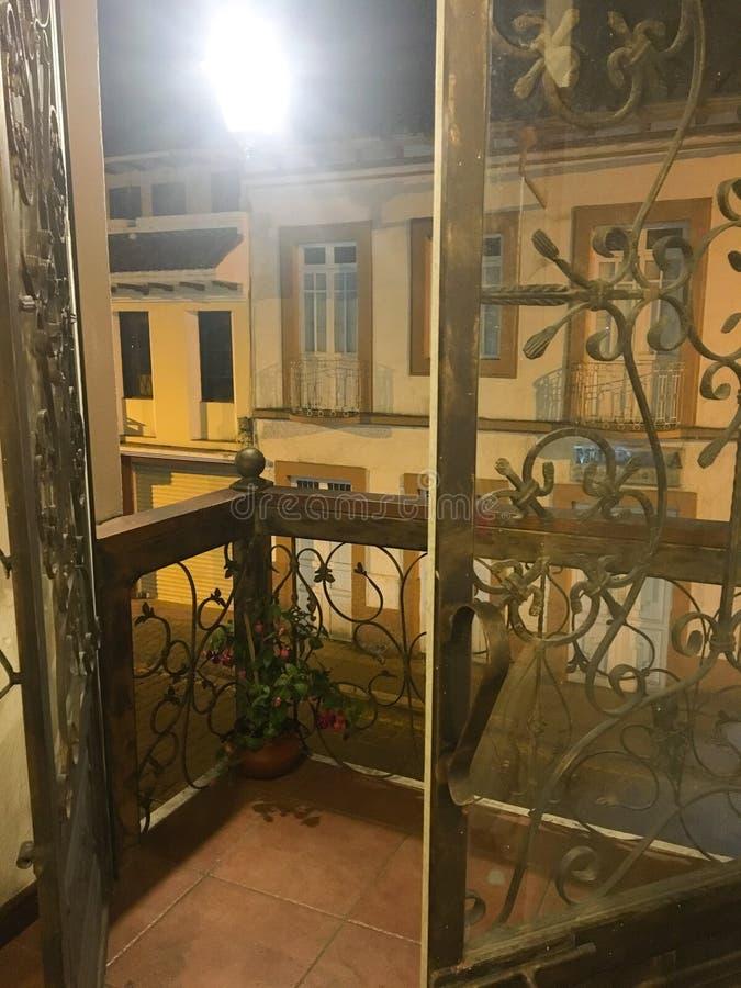 IRON FRENCH DOORS ON BALCONY, CUENCA royalty free stock photos