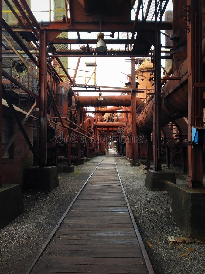 Iron Furnaces. Steel, ore, melt, molten, metal, metals, industry, industries, industrial, old, historic, historical, factory, manufactoring, orange, color stock photos