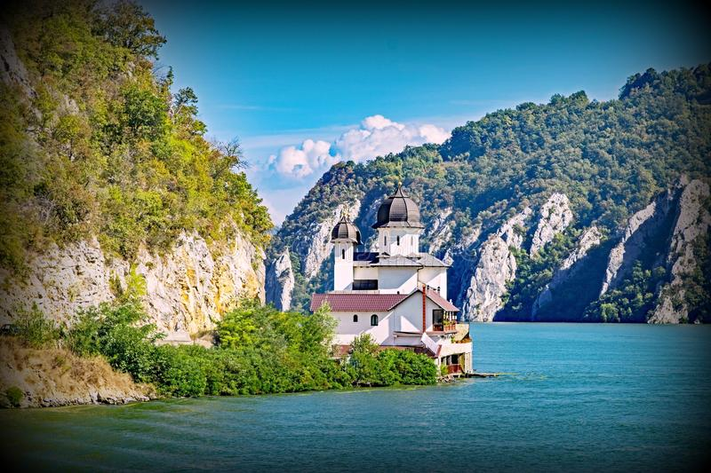 Iron Gate on the Blue Danube. This small church is located in the spectacular narrow gorge on the Danube River known as the Iron Gate royalty free stock photo