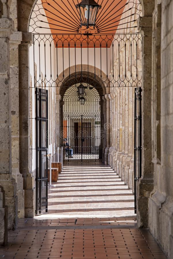 Iron gated Spanish colonial passageway stock photos