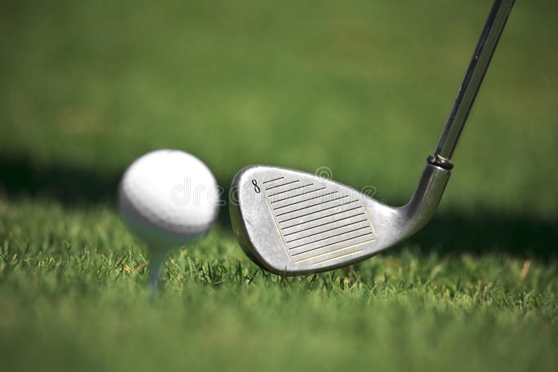 Iron And Golf Ball Royalty Free Stock Photography