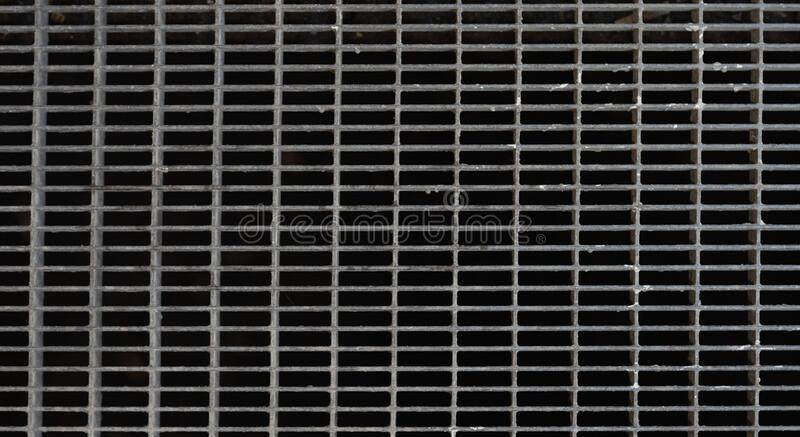 Iron grate of water drain or waterway parallel pattern. stock photo