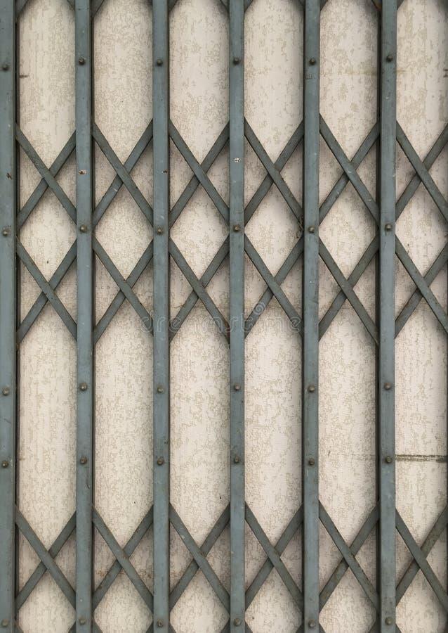 Iron grunge metal door and wall texture stock image