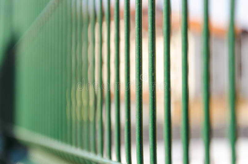 Iron jail cell bars. A perspective view of iron jail cell bars royalty free stock photo