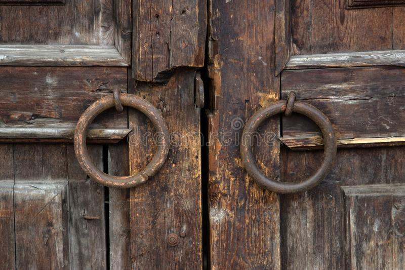 Iron knobs on old wooden gate, background. royalty free stock photos