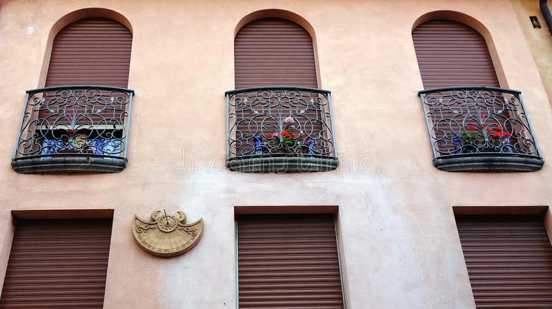 Iron Lace Balconies on Stucco Wall stock photos