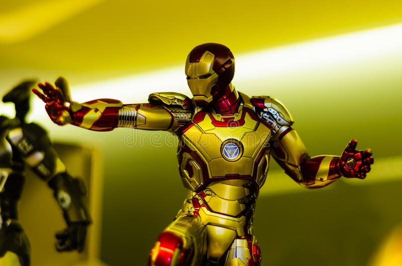 Iron Man Figurine. Realistic figurine of Iron Man comic character on a sophisticated toy and collection shop royalty free stock photos