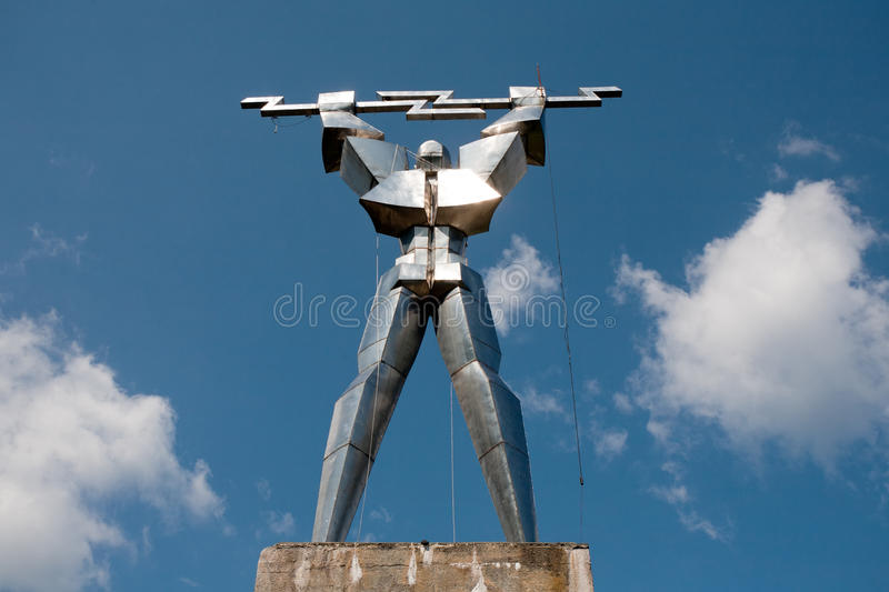 Iron man. Statue of iron man with lightning in hands, Romania royalty free stock images