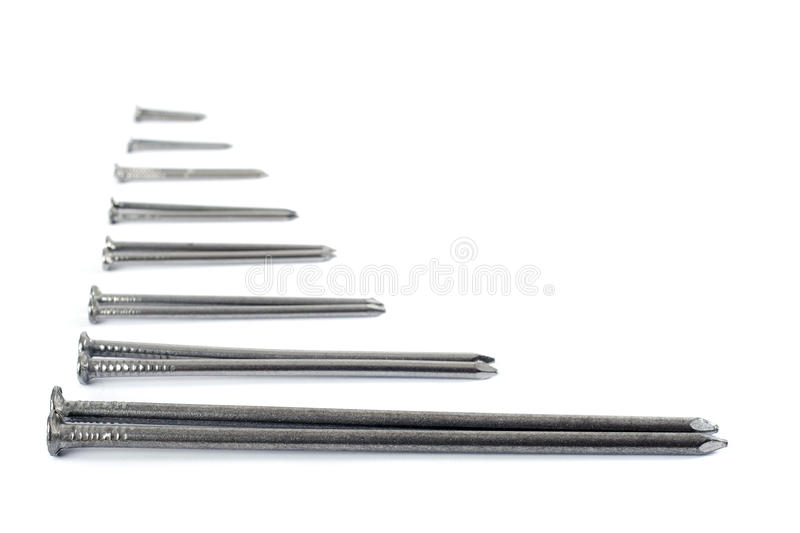Iron nails isolated on white. Iron nails abstract isolated on white background royalty free stock photos