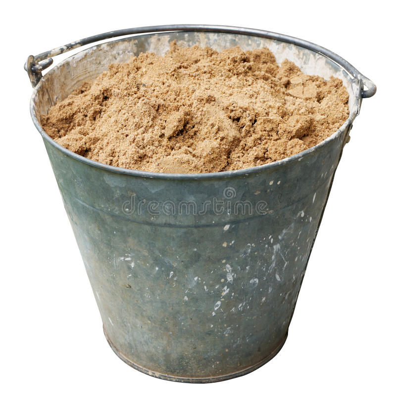 Iron old construction bucket with clean sand. royalty free stock images