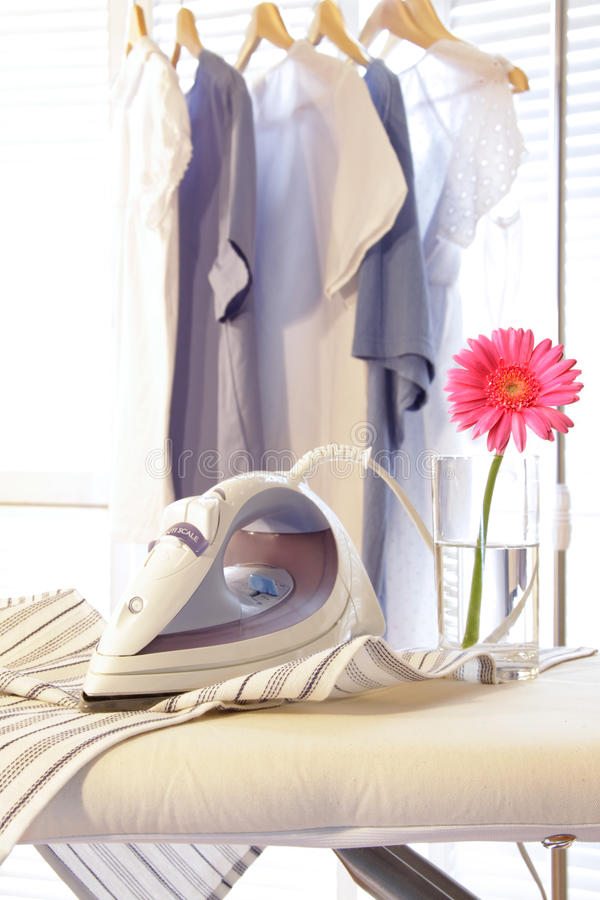 Free Iron On Ironing Board In Laundry Room Royalty Free Stock Photos - 10764748
