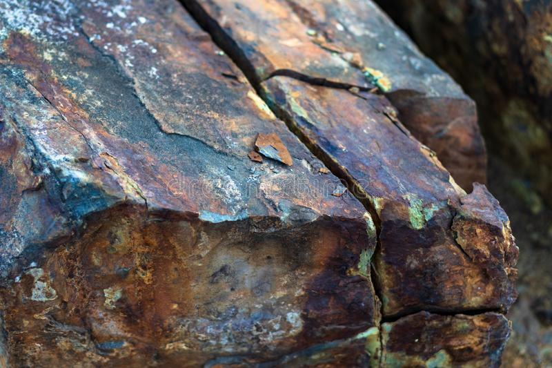 Iron ore mineral rich cut ornamental stone with cracks stock image