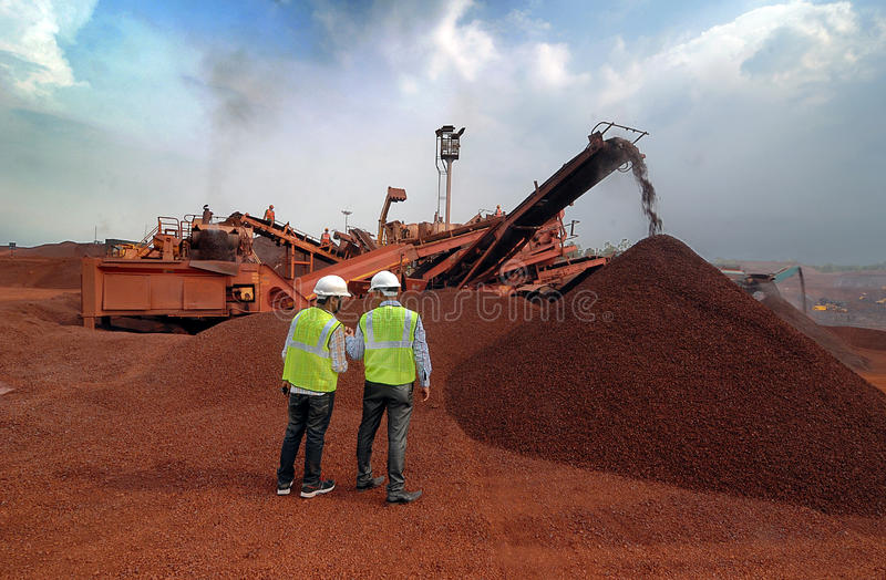 Iron-ore Mines In India. Two engineers at the iron-ore mine in Barbil-Orissa.The region around Barbil has the fifth largest deposit of iron ore and manganese ore royalty free stock image
