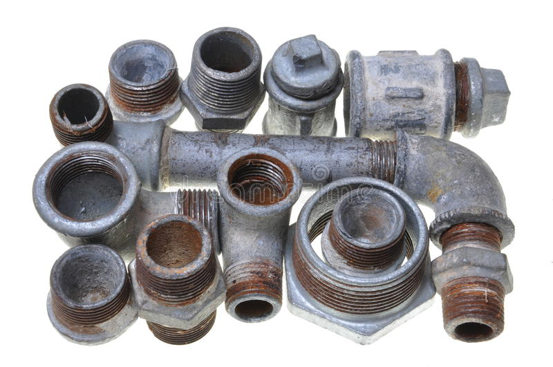 Iron pipe fittings for plumbing stock photography