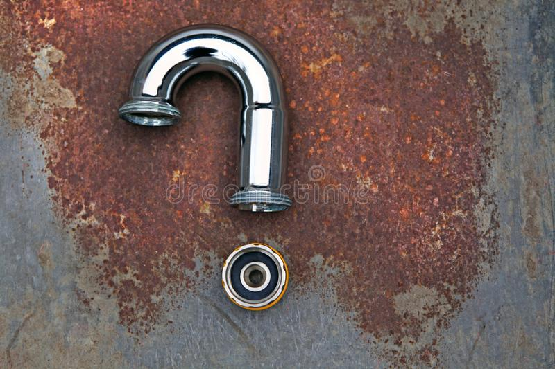 Iron pipe question mark rusty metal background nobody. Day light stock images