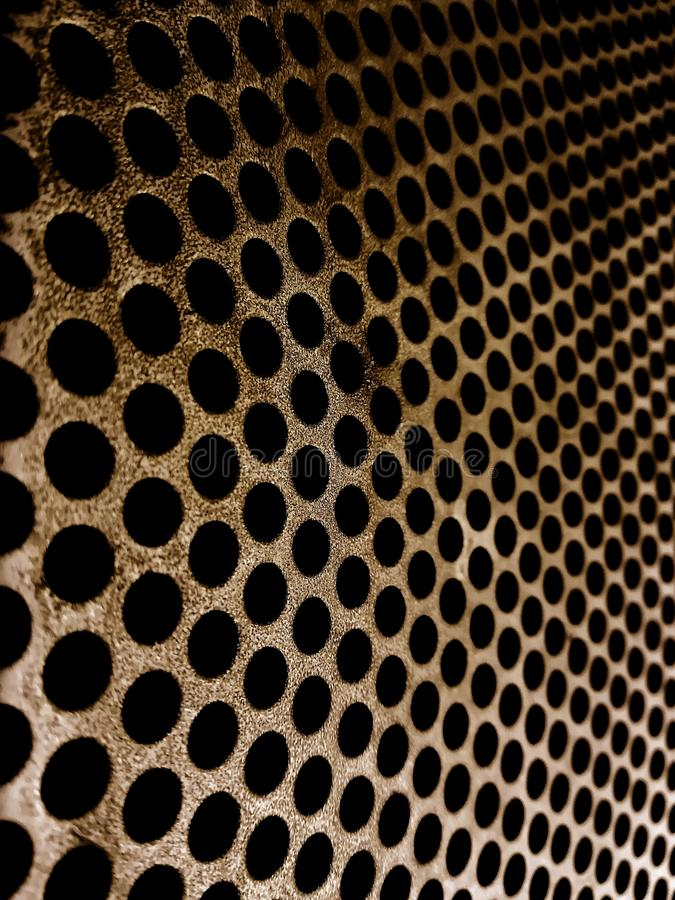 Iron plate with regular little holes texture stock photography
