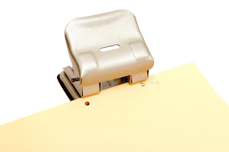 Iron Punch. Makes a hole in a sheet A4 royalty free stock photography