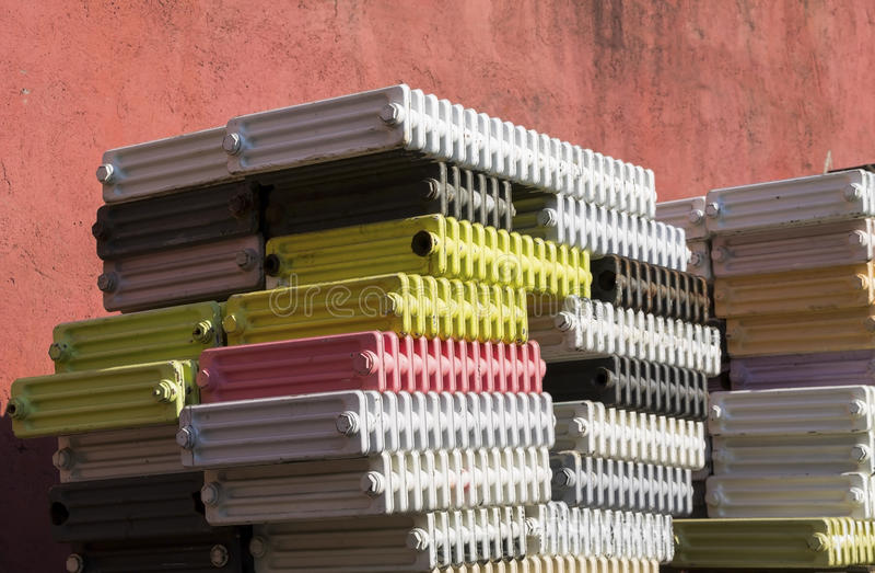 Iron radiators. Heap of rusty household iron radiators royalty free stock photography