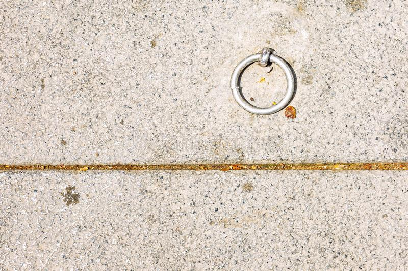 Iron ring in the concrete floor. Close-up. Space for text. Horizontal royalty free stock photos