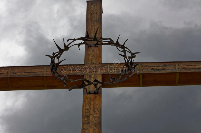 Iron ring in the cross. Closely looking iron ring in the cross with dark sky royalty free stock images