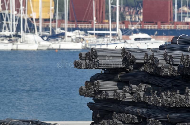 iron rods in carrara harbour stock photo