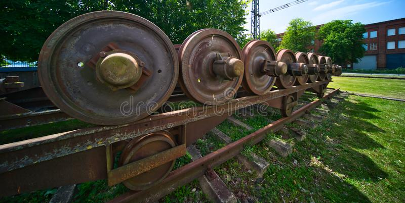 Iron rusty wheels from railway wagons that are stored in maintenance operations and waiting to be restored royalty free stock photos