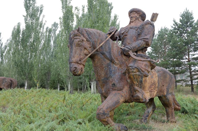 Iron statue of the hussar of genghis khan, adobe rgb. Iron statue of genghis khan`s cavalry, ordos city, china stock image