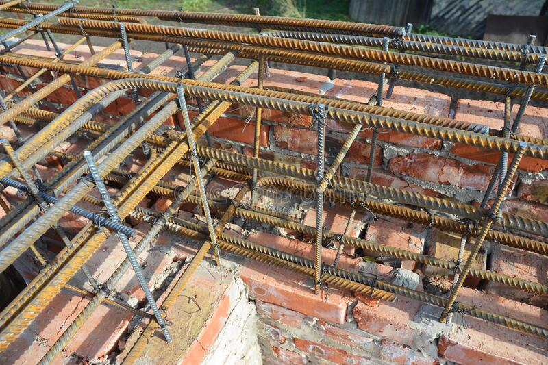 Iron, steel bars reinforcement, a mesh of steel wires in masonry foundation wall house construction. Photo stock photos