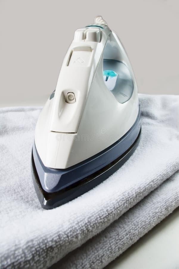 Iron on towel royalty free stock image